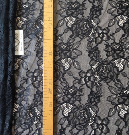 Black floral pattern lace fabric . Photo 6