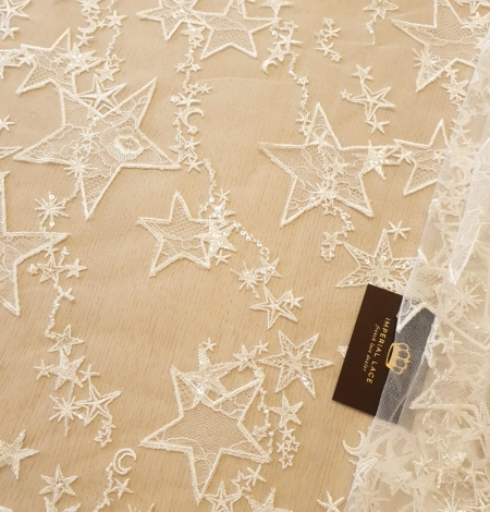 Ivory 100% polyester star pattern embroidery on tulle with beads and chantilly details lace fabric. Photo 1