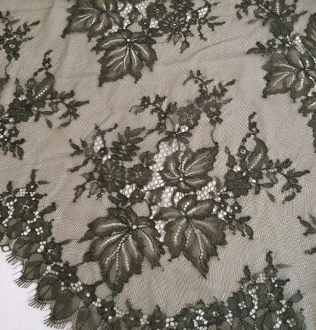 Tobacco green lace fabric. Photo 1