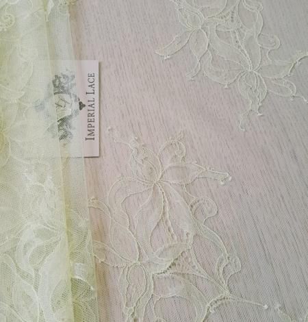 Light yellow lace fabric. Photo 1