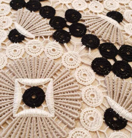 Beige with black and white macrame lace fabric. Photo 3