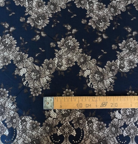 Dark blue with brown flower pattern lace fabric. Photo 6