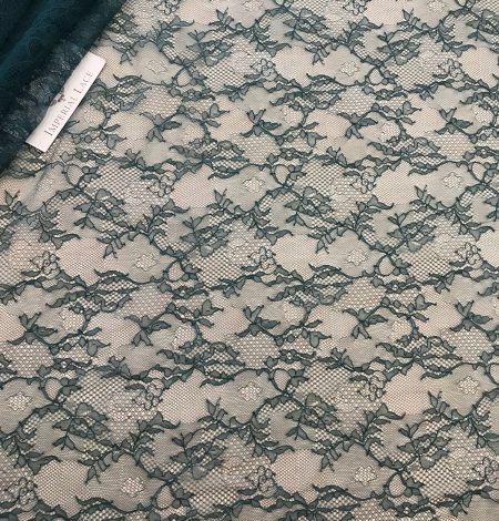 Deep teal green lace fabric. Photo 10