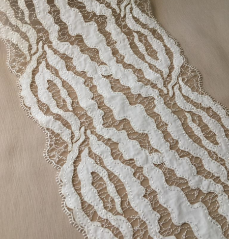 Elastic ivory lace trimming. Photo 1