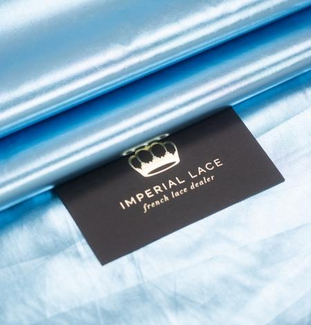 Blue color shiny rain coat fabric. Photo 1
