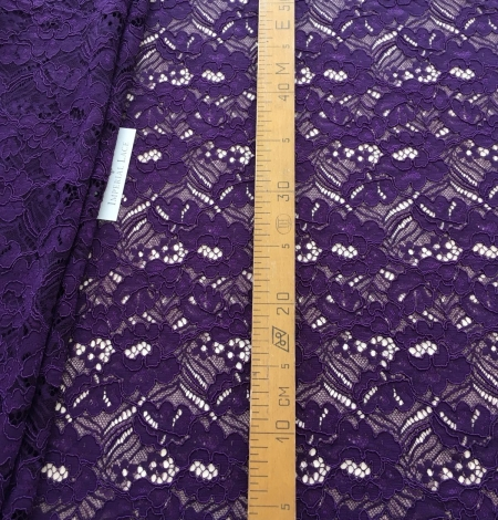 Violet guipure lace fabric. Photo 7