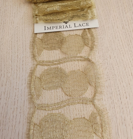 Gold chantilly lace fabric. Photo 1