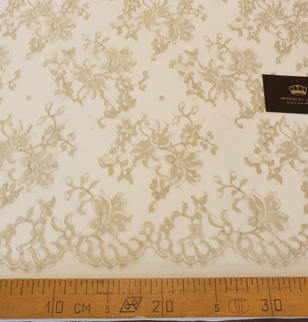 Ivory with gold thread viscose lace fabric. Photo 6