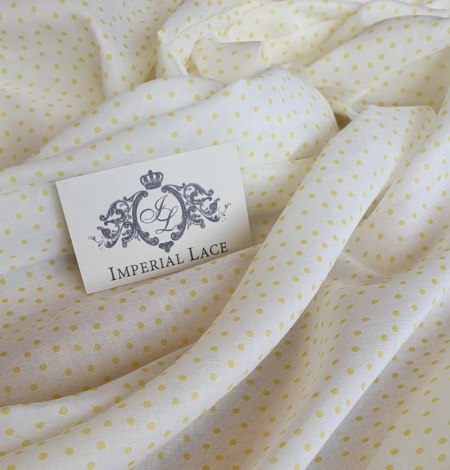 White with yellow dots cotton fabric. Photo 1
