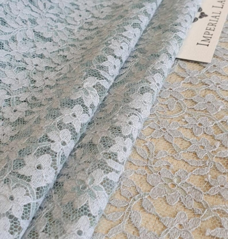 Grey with bluish green base lace fabric. Photo 3