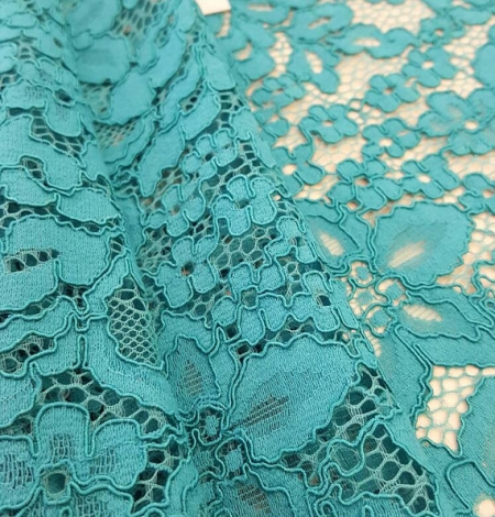 Turquoise guipure lace Fabric. Photo 3
