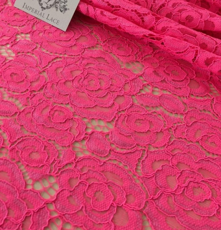 Electro pink guipure lace fabric. Photo 1