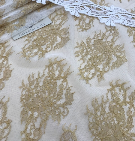 Gold lace fabric. Photo 3