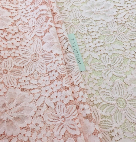 Salmon pink floral guipure lace fabric. Photo 1