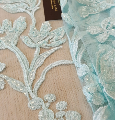 Blue floral pattern sequin embroidery on tulle fabric. Photo 2