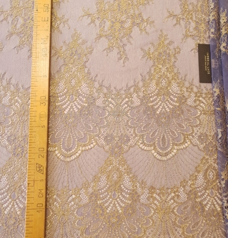 Purple with gold chantilly lace fabric. Photo 8