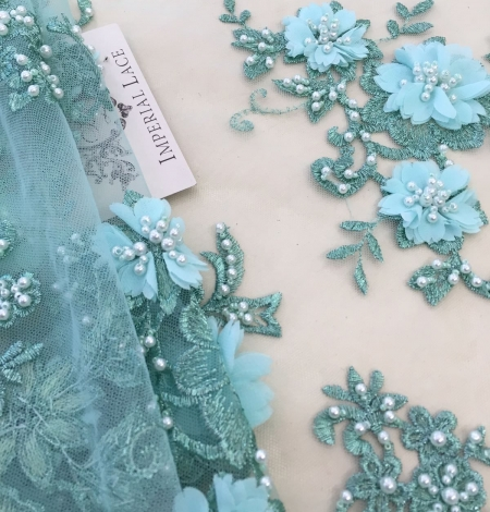 Green 3D lace fabric. Photo 1