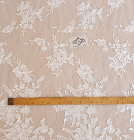 Ivory beaded floral pattern embroidery on tulle fabric. Photo 7