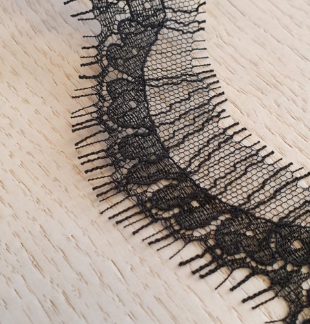 Black natural chantilly lace fabric by Jean Bracq. Photo 4