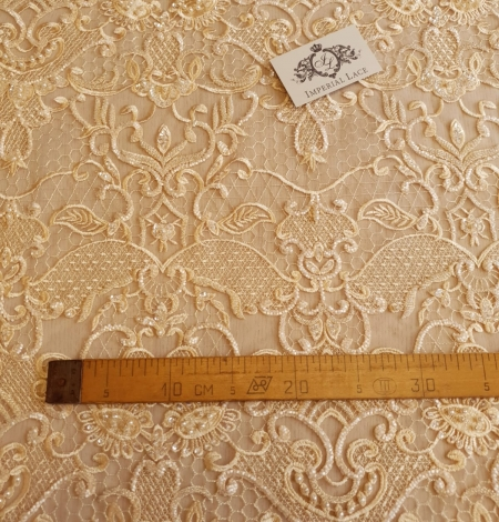 Yellow beaded lace fabric. Photo 5
