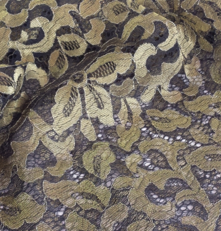 Black with gold Lace Fabric. Photo 1