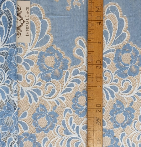 Light blue with white flower pattern fabric. Photo 7