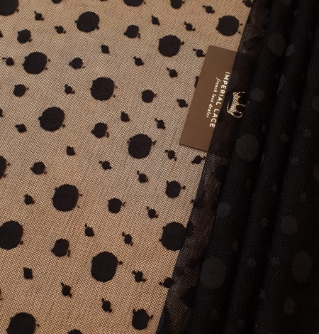 Black 100% polyester abstract circle pattern tulle fabric. Photo 1