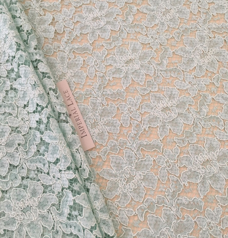 Mint green lace fabric. Photo 1