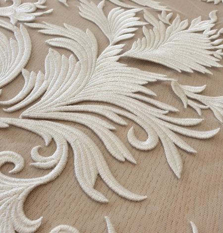 ivory thick embroidery on tulle fabric. Photo 6
