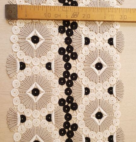 Beige with black and white macrame lace fabric. Photo 8