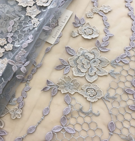 Greyish blue embroidery on tulle fabric. Photo 6