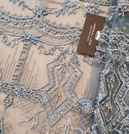 Greyish blue beaded with hanging details embroidery on tulle. Photo 1