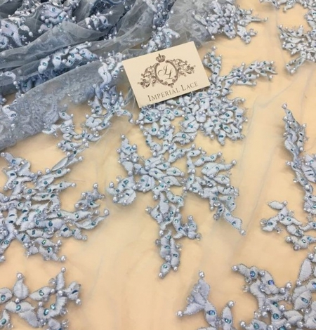 Light blue with crystals embroidery on tulle fabric. Photo 1