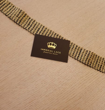 Gold and black elastic ribbon application. Photo 8