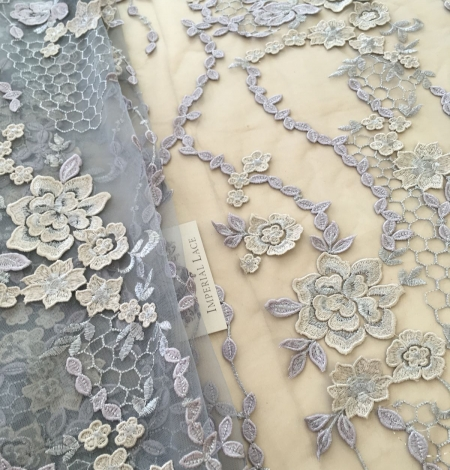 Greyish blue embroidery on tulle fabric. Photo 7