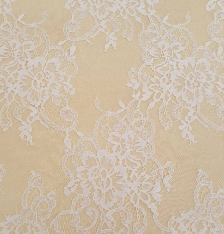 White with lilac shade chantilly lace fabric. Photo 2