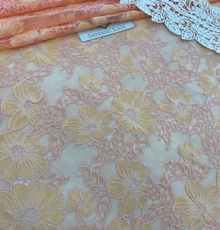 Orange lace fabric. Photo 2