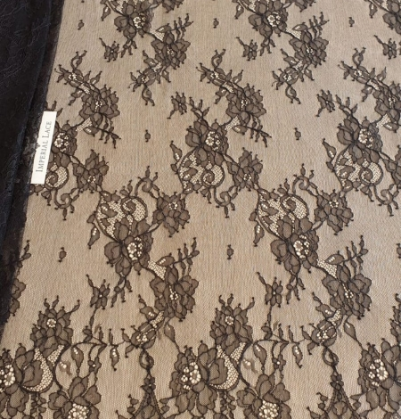Black floral Chantilly lace fabric. Photo 2